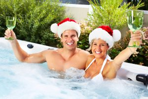 couple enjoying a hot tub at Christmas time