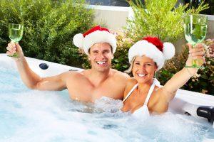 couple enjoying a hot tub at Christmas time